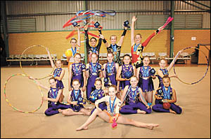 Coffs Harbour rhythmic gymnasts celebrate their big haul of medals and trophies at the NSW country championships.