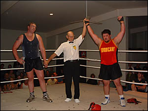 Grafton fighter Eddie DeBono, right, is hailed as the winner after his super-heavyweight amateur boxing bout against Yamba figh
