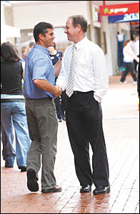 You?re our man . . . a passerby stops to shake the hand of suspended MP Andrew Fraser, right, in the City Centre yesterday.