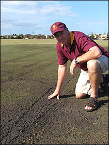 Tintenbar-East Ballina Cricket Club treasurer Don Hogden surveys the damage done by vandals to the wicket square at Kingsford S