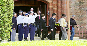 Police form a guard of honour as Jim O?Connor?s coffin is carried from St Carthage?s Cathedral.