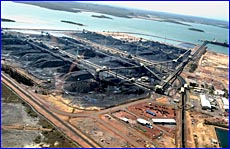 Gladstone's expanding coal facilities may be hit by lower coal prices, according to one analyst.