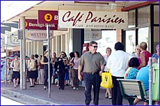 Gladstone city centre workers are evacuated from their shops and offices during yesterday?s gas leak.