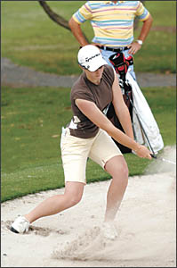 Emma Bennett blasts a shot out of the greenside bunker on her way to winning the Ladies Classic, the feature women?s event at t
