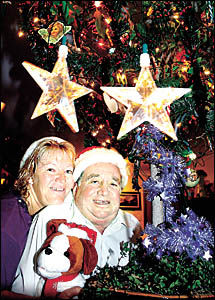 MERRY CHRISTMAS: Cassandra and Fred Parker get into the spirit of Christmas at their Richmond Hill home, which is already decke