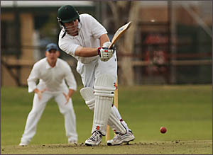 PADDED AWAY: South?s Michael Fletcher is tucked up with a tight ball from Tucabia opening bowler Chris Adamson.