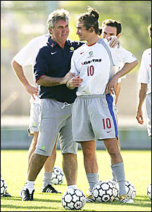 PENNY FOR YOUR THOUGHTS? Coach Guus Hiddink and Socceroo Harry Kewell in Argentina preparing for the crunch match against Urug