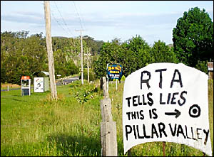 WHERE ARE WE: A protest sign in Pillar Valley angry at the RTA displaying the town 1.5km from where it actually sits.