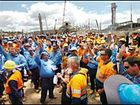 Disgruntled construction workers vote to down tools over safety issues on the Orica expansion site yesterday.