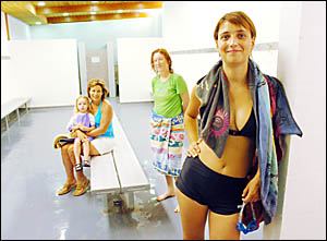 OPINIONS DIVIDED: Bathers in the women?s change rooms at the Lismore Memorial Baths yesterday (from left) Lee Barkas, of Lismor