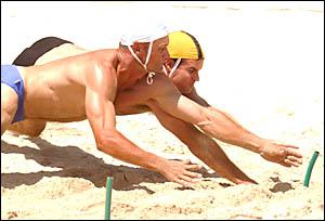 BIGDIVE: Yamba?s Clint Patricks dives to take out the open men?s beach flag.