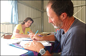 Writing letters of protest about planned upgrades of the Pacific Highway are Robyn Ravenna of Pillar Valley and John Boyle of D