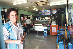 Woolgoolga businesswoman Christine Munro is fed up with constant power outages and the risk they pose to her seafood.