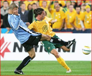 Australia's Harry Kewell takes it to a Uruguay player in last night's match. Picture: Getty Images