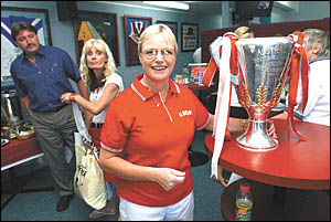 Jill Woodlock was able to touch the AFL Premiership Cup this week and received her own prize for her service to sport, especial