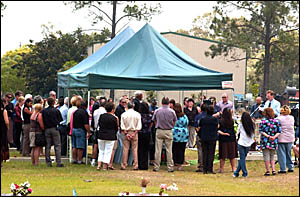 Mourners show their respects for Mark Stoker.