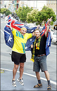 MURWILLUMBAH soccer fan Jim Sparks (left) and Stefan Schwarz celebrate the Socceroos? victory against Uruguay in Wednesday nigh