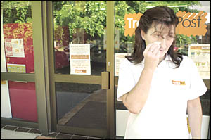 NUMBER DISCONNECTED: Paula Anderson, an employee at the Trading Post office in Ballina, after being told yesterday the office i
