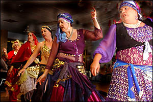MEMBERS of the Turkish Delights Belly Dancing Troupe entertain the crowd at the Pink and Black Masked Ball and Auction.
