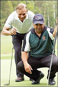 Carlton veteran Syd Jackson keeps a close eye on tournament leader Shaun Nannup at the National Indigenous Golf Titles.
