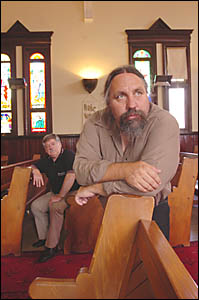 OPPOSED: Uniting Church Reverend Bob Rutherford (left) and Pastor Garry Dronfield are concerned about planned workplace changes