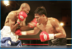 QUALITY COMPETITION: Somchai Nakbalee lays into South African One Boy Makwelo.