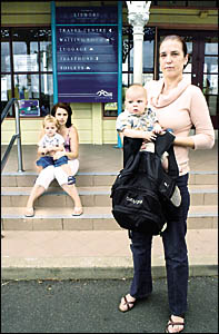 TRAVELLING BLUES: Lynelle Hotlby, holding five-month-old Jake, and the nappy bag which she was told was too big to take on a bu