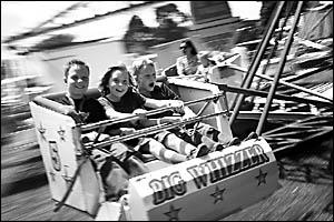 Matthew Winkel, George Stephens and Nicholas Winkel, loved the rides at the Dorrigo Show on the weekend.