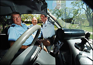 Looking over new security cameras installed in Grafton taxis are owner-operators Garry Thurgate and Alex Johnston with Sgt Chri