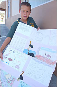 PEOPLE POWER: Marc Adamson, 11, of James Creek with his posters of Emus that live in his area. Posters and other children?s mat