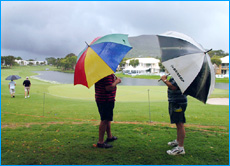 Golf fans watch hopelessly as storm clouds end any hopes of play at the PGA Championship yesterday.