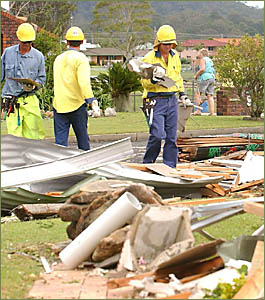 CLEAN-UP: A Country Energy crew from Murwillumbah helps clean up damage at Iona Close, Maclean.