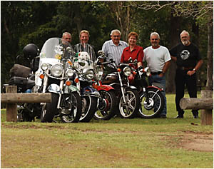 Toy run roars towards successTOY BOYS (AND GIRL): Gearing up for Christmas and their annual toy run today are bikers Barry Will