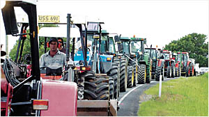 HEAVY TRAFFIC: Included in yesterday?s 15km/h convoy from St Helena to Ballina along the Pacific Highway were 18 tractors.