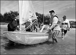 Chris Sheehan and Les Clack get ready to take to the water in one of the three Access dinghies being used for the Sailability s