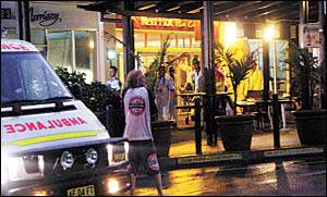 A MAN is taken on stretcher out of the entrance to the Paradiso building in Kingscliff last night. The man is believed to have