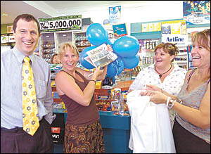 Jess Fitzgibbon picks up her copy of the Coffs Coast Advocate on Thursday and makes history by becoming the one-millionth perso