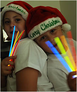 GLOWING:Ashlee and Zahli Stevens are selling glowsticks at their decorated Goodward Street home for $1 each, in aid of the Stok
