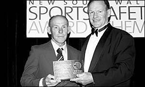 Jim Graham receiving the award from Peter Wynn.