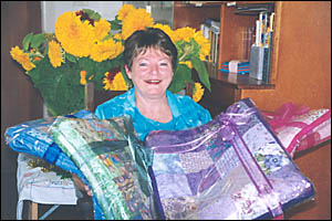 GIFTS OF LOVE: The Stoker girls? great aunt, Kerry Little, yesterday accepted four handmade quilts on their behalf. Maclean Pat