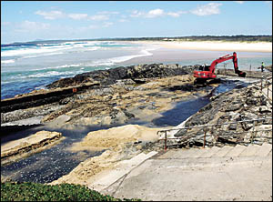 Sawtell?s ocean swimming pool receives its annual clean out with an excavator from the Coffs Harbour City Council.