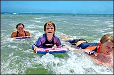 Janice Robinson from Boyne Island and her sons Jeremy, 9, and Sam, 12, cooled off at Tannum Sands beach.