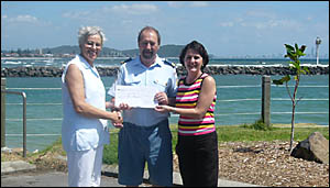 HAPPY SAILING: Local resident Lesley Bryant hands over her donation of $25,000 to Currumbin Volunteer Marine Rescue president,