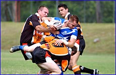 Wallabys and Valleys players clash during CQ Extended League premiership action last season.
