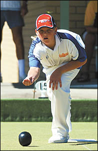 Josh McMaster sends down a bowl during the final of the junior club pairs at West Coffs recently.