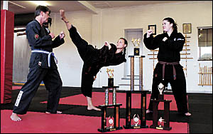Martial arts students, Ian Farmer, Cheyenne Hoffman and Jody Whitley go through some of their routines.
