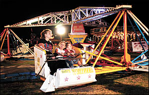 The Whizzer is one of the many thrills and spills at the Coffs Jetty Christmas Carnival.