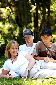 Judy Mitchell relaxes at home with sons Steven, left, and Matthew.