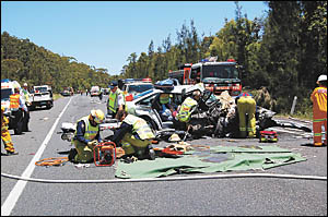 Carnage . . . this two-car smash blocked the Pacific Highway at Corindi for 90 minutes yesterday afternoon.