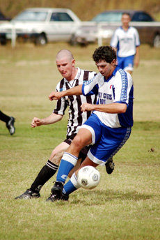 Gladstone United?s Graeme Turner (left) was named men?s best and fairest player for 2005.